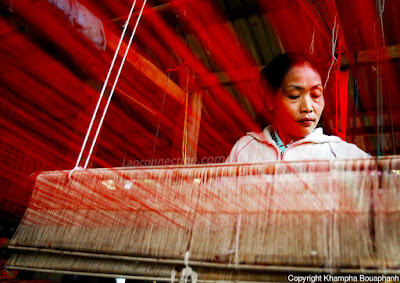 Woman in Luangprabang using the loom to create textile fabric. Photo Credit:  Khampa Bouaphanh