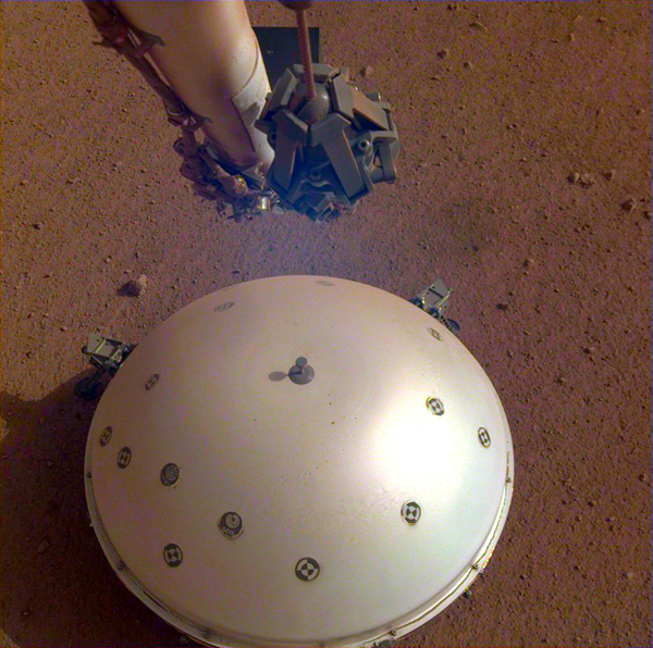 An image of the Wind and Thermal Shield dome that was placed atop the seismometer of NASA's InSight Mars lander...as seen on the 110th Martian day, or sol, of the mission.