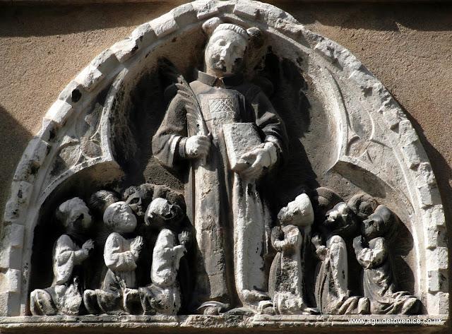 Bas-relief of St Stephen, Scuola di Santo Stefano, Campo Santo Stefano, Venice