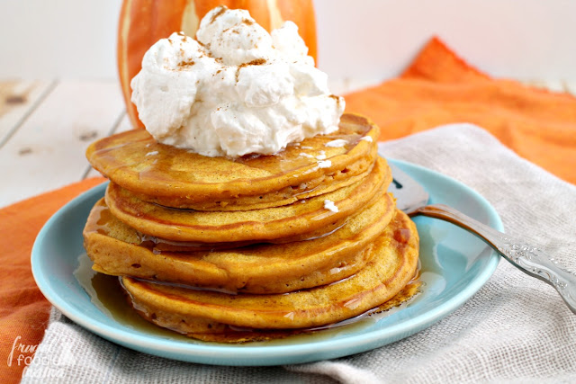 Enjoy all the deliciousness of a slice pumpkin pie for breakfast minus the guilt with these healthier Pumpkin Pie Greek Yogurt Pancakes.
