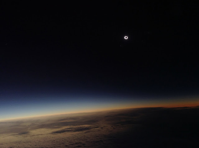 Total Solar Eclipse seen from plane above Atlantic Ocean