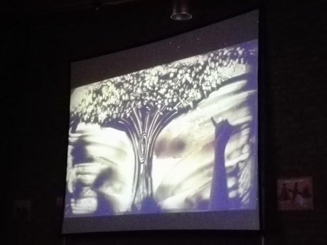 Zandschilderij van de zandprinses: de schepping.