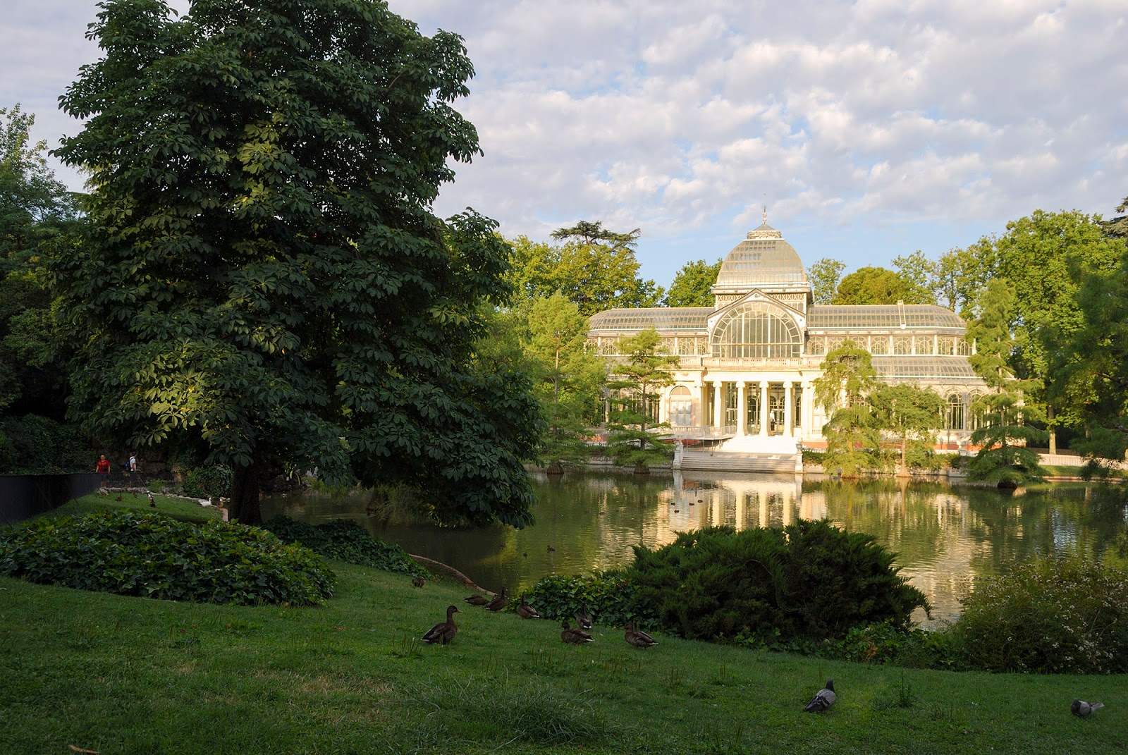 retiro park pond lake monument palace crystal glass madrid