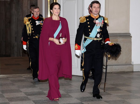 Crown Princess Mary wore red cape, Gianvito Rossi suede pumps, Diamond Tiara, Hugo Boss clutch, Carlend Copenhagen Clutch, diamond earrings, Prada handbags