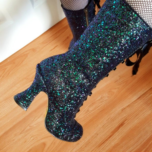 curved heel glitter boots close up