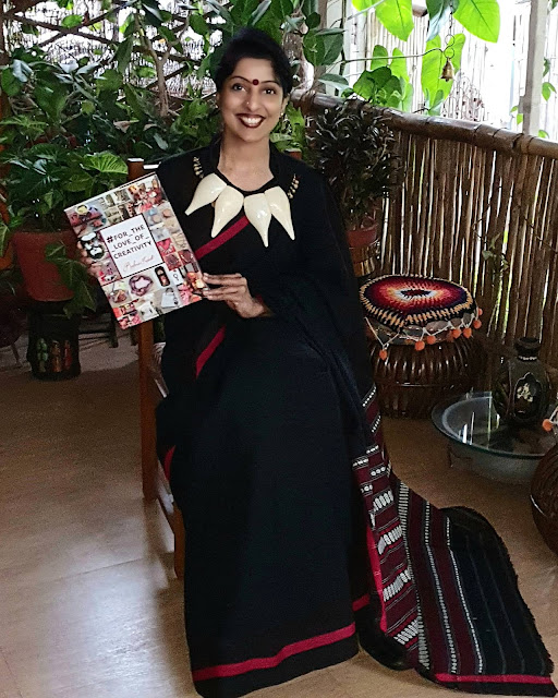 Reshma Kadvath with her coffee table book on recycled crafts