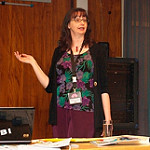 photo of Kathy Dempsey speaking at a conference