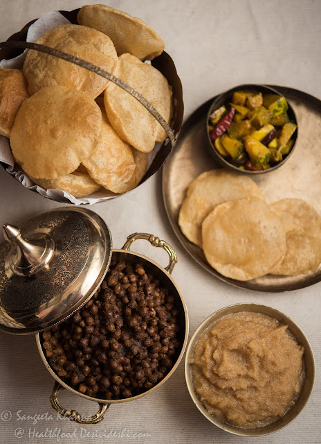 poori chana and halwa meal