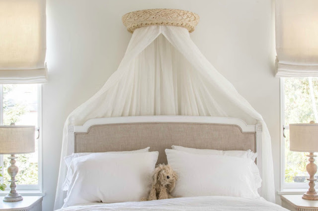 Romantic linen upholstered bed in French farmhouse style bedroom - found on Hello Lovely Studio