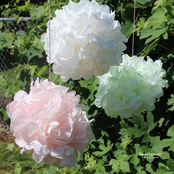 Tissue paper pom pom balls for party decorations. Learn to dye them and make them in this full tutorial.