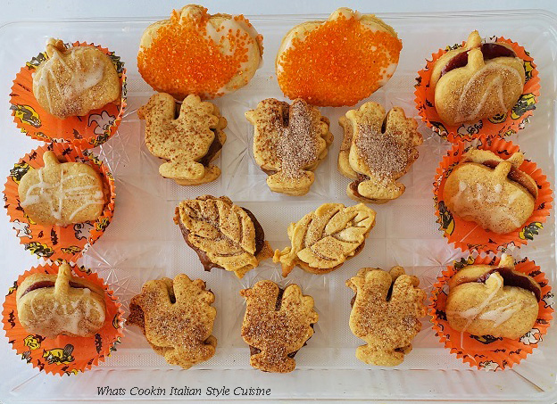 This is a shortbread cookies cut into Turkey shapes, pumpkin and leaf patterns then filled with jams and melted chocolate