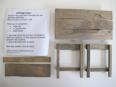 Dolls' house miniature potting table kit, components laid out, with instructions.