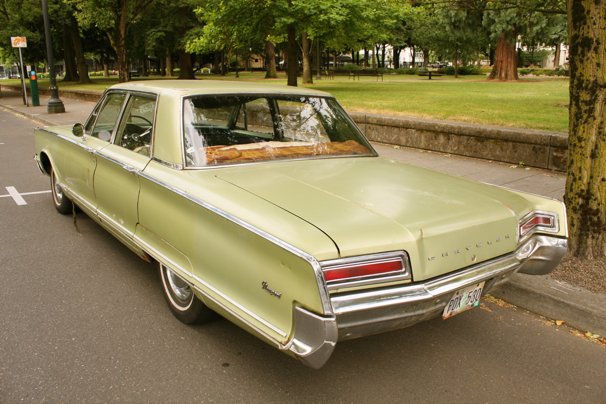 OLD PARKED CARS 1966 Chrysler Newport Sedan