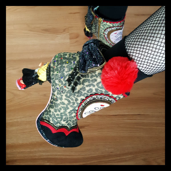 detailed view of Irregular Choice Disney Muppets Fierce Piggy boots on foot