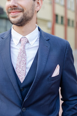 groom with navy suit with pink floral tie