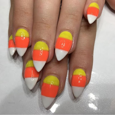 Using candy corn as your holloween nail art inspiration.