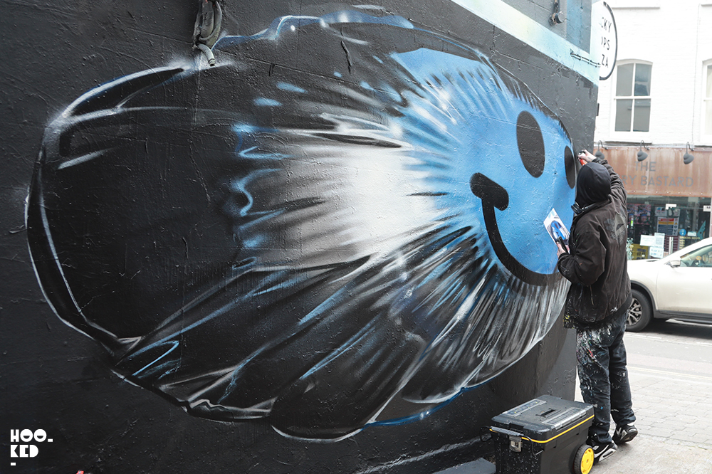 Artist Fanakapan at work on a 3D graffiti mural in London