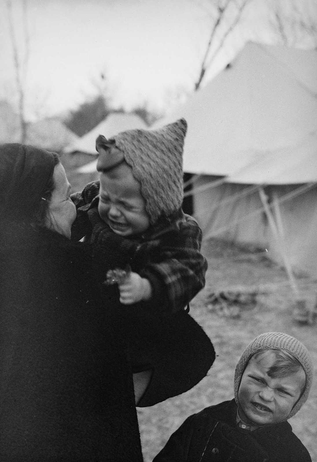 A Polish woman holds her baby girl at an evacuee camp in Tehran.
