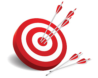 Bullseye target with arrows in the center