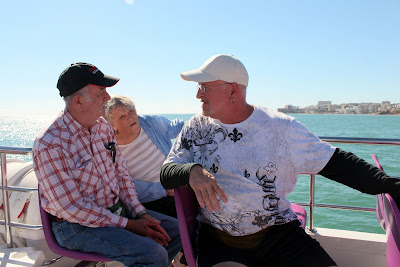 On a boat in Spain - using the  reflected light while shooting into the sun makes a photo they will love