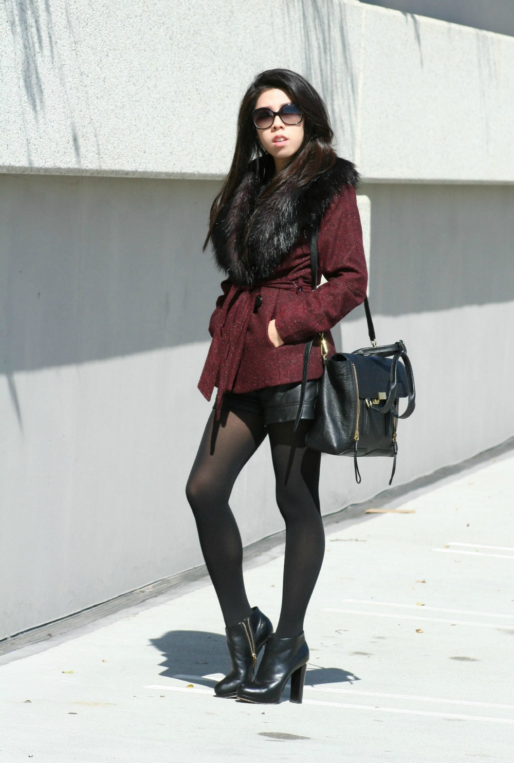 All Black Outfit_Black Michael Kors Leather Booties_Zara Lace Long Sleeve Bow Top_Leather Shorts_H&M Faux Fur Burgundy Coat
