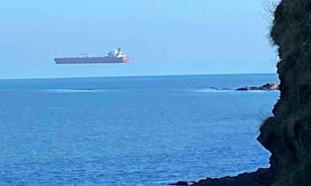 Ship Floating On Air' Off The Coast Of Cornwall