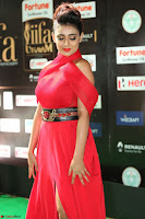 Apoorva in a Stunning Tight Leg Split Sleeveless Red Gown at IIFA Utsavam Awards 021.JPG