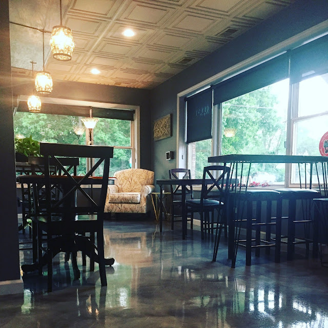 Cafe seating at Coquelicot. Image credit Coquelicot.