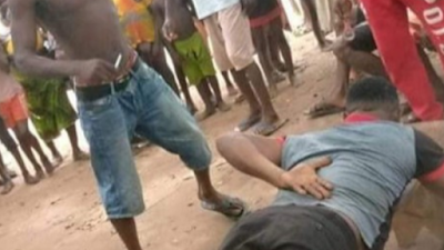 (Photos) Youths Flog Pastor Publicly For Sleeping With A Married Woman