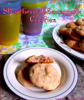 Strawberry Cheesecake Cookies, it's the surprises inside that ramp up the flavor and texture. | Recipe developed by www.BakingInATornado.com | #recipe #cookies