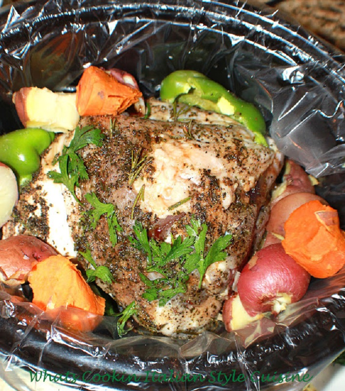 this is a whole pork tenderloin inside of a slow cooker with vegetables