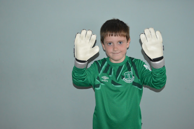Boy with goalkeeper gloves on