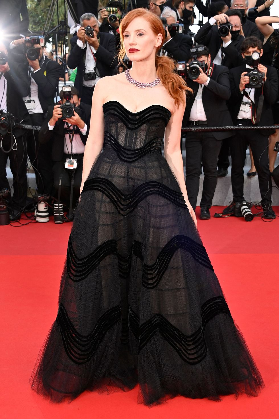 Jessica Chastain Jessica Chastain famously walked the red carpet at the 2021 Cannes Film Festival opening ceremony, which also saw the premiere of Annette, wearing a strapless black Dior dress and Chopard jewelry.