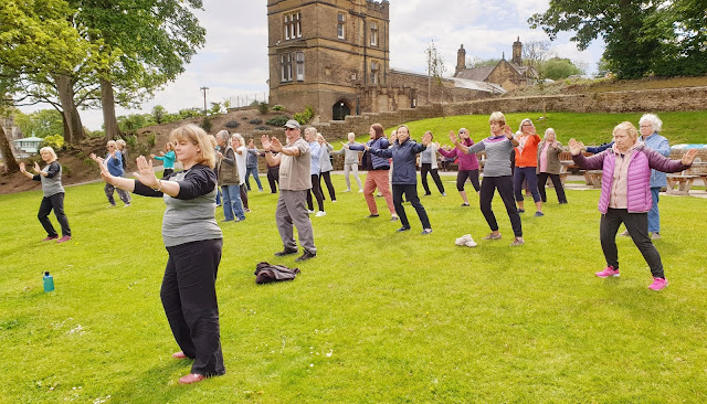 People enjoy a Tai Chi & Qigong class at Cliffe Castle Park, Keighley