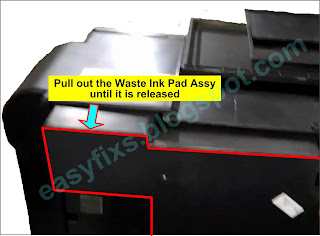 Pull out the Waste Ink Pad Assy until it is released