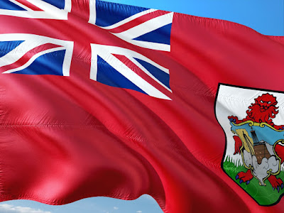 Bermuda's flag flapping in the wind against a blue sky background