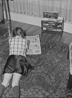 1940s girl reading comics