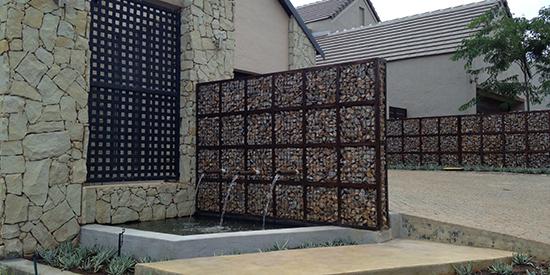 desain pagar minimalis menggunakan sistem bronjong