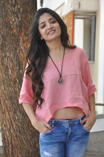 Poonam Kaur in a light Pink Crop Top and Denim jeans at Attach Movie Audio Launch
