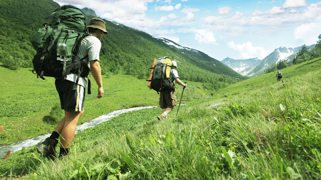 Two people backpacking in mountains