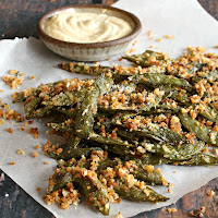 Crispy, oven roasted sugar snap peas with olive oil, cheese and seasoning.