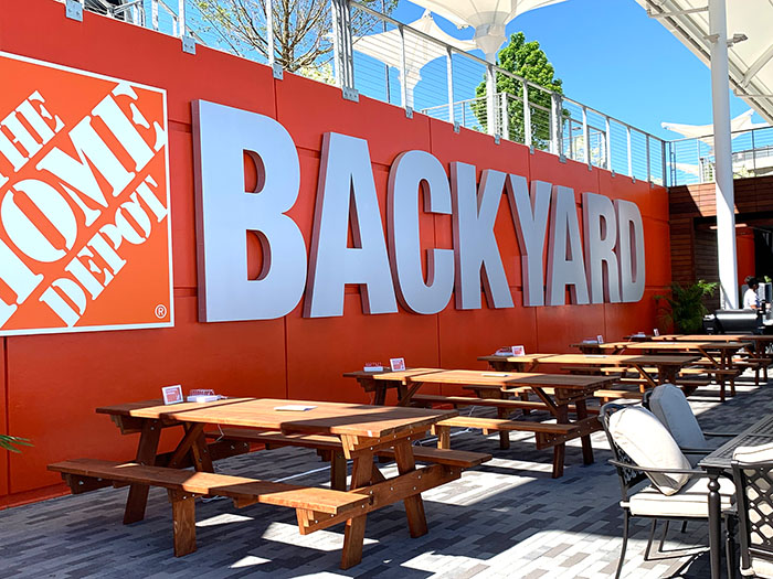 Home Depot Backyard sign at Mercedes Benz Stadium - Picnic tables