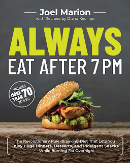 The cover of Always Eat After 7pm by Joel Marion shows a chicken sandwich covered in leafy greens sitting on a slate slab plate with a dark gray wall behind