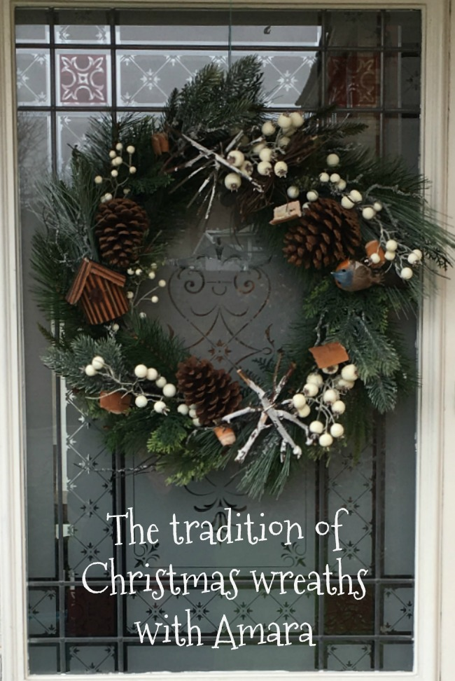 the-tradition-of-christmas-wreaths-with-amara-text-over-image-of-wreath-on-door