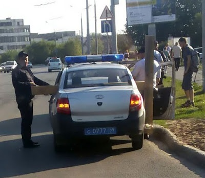 'Jesus' Spotted In Russian Street Carrying Cross, Arrested By Police, See Photos