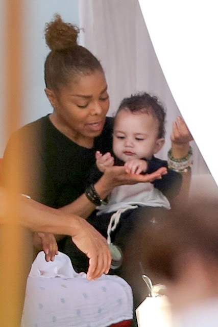 Janet Jackson pictured feeding her baby son Eissa in Miami Beach, Florida