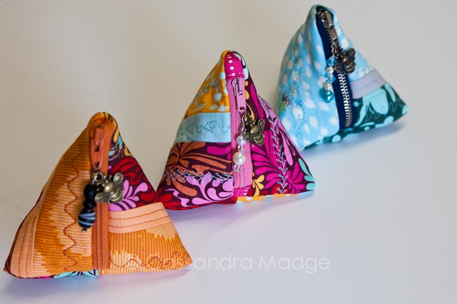Three Quilted Triangle Pouches, orange, pink and blue, by Cassandra Madge