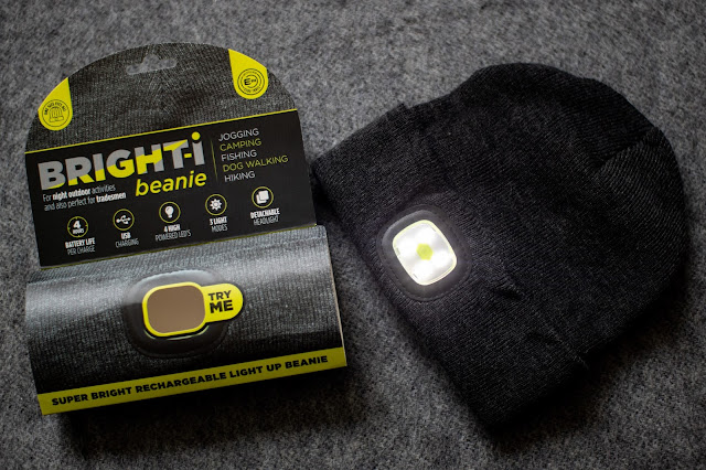 The beanie packaging and the hat with the light turned on and 4 LEDs visible
