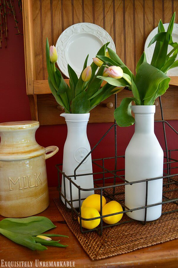 Antique Farmhouse Milk Crate with flowers in milk glasses, lemons on a pine server