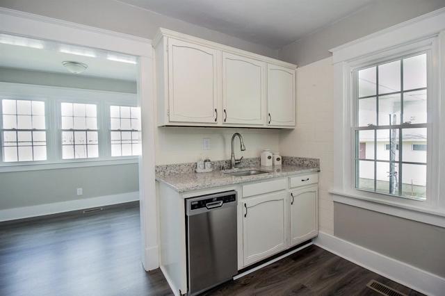 kitchen with craftsman trim on doorways and windows • 24 Massie Avenue, Paris, Kentucky, Sears Norwood model